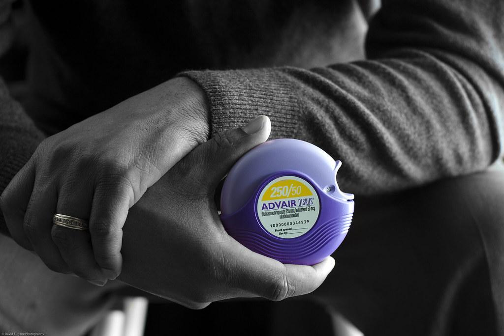 Photo of hand holding a AdVair brand powder inhaler