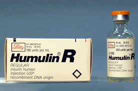 Photo showing package of Humulin R with vial next to it.
