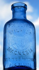Photo showing empty Milk of Magnesia bottle